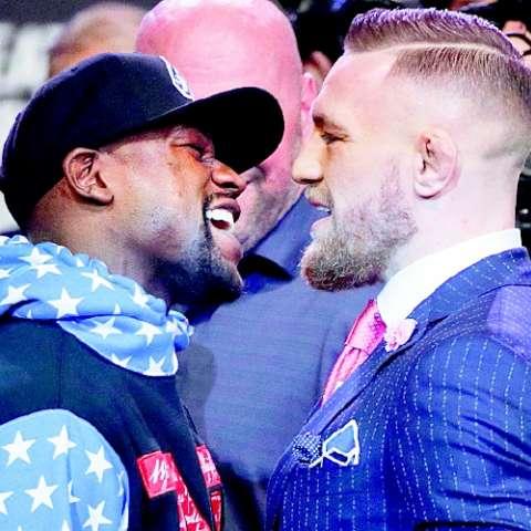 Floyd Mayweather Jr. (izq.) y Conor McGregor. Foto: AP
