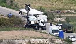 Vista general del lugar donde falleció la periodista maltesa Daphne Caruana Galizia al explotar su coche en Bidjina (Malta) ayer. EFE