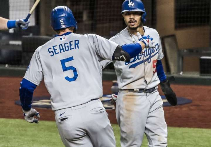 Dodgers se mantienen con vida al vencer a los Bravos 7-3