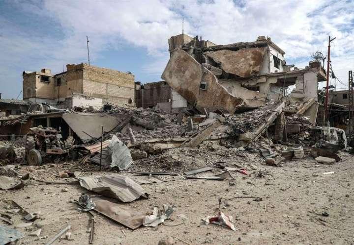 Edificios destruídos tras un bombardeo al este de Guta, en Duma en Siria. EFE Archivo
