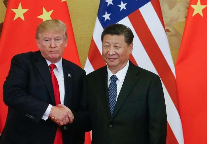 En la imagen, el presidente estadounidense, Donald J. Trump (i), y el presidente chino, Xi Jinping (d). EFE