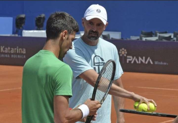 Novak Djokovic (izq.) y su entrenador Goran Ivanisevic.