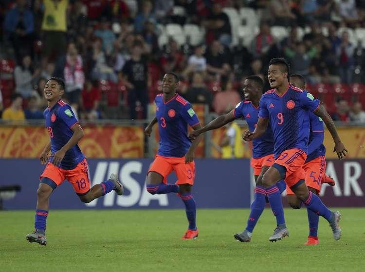 Jugadores de Colombia celebran la victoria ante Nueva Zelanda. Foto: AP