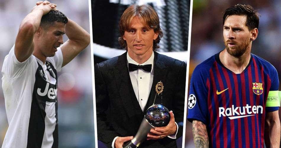 Luka Modric (c), Cristiano Ronaldo (izq.) y Leionel Messi.