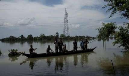 Las inundaciones generalizadas en el estado de Assam han sido causadas por lluvias torrenciales de temporada, que también provocaron el desalojo de unas 1,2 millones de personas.  /  Foto: AP